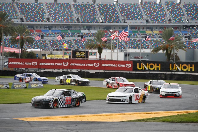 A group of Xfinity Series drivers, led by Masson Massey in the No. 99 Ford, make their way through the infield of the Daytona Road Course  on Saturday during the weather-delayed UNOH 188 at Daytona International Speedway. The course was put together after the Speedway was given the weekend of races that normally would have been at Watkins Glen.