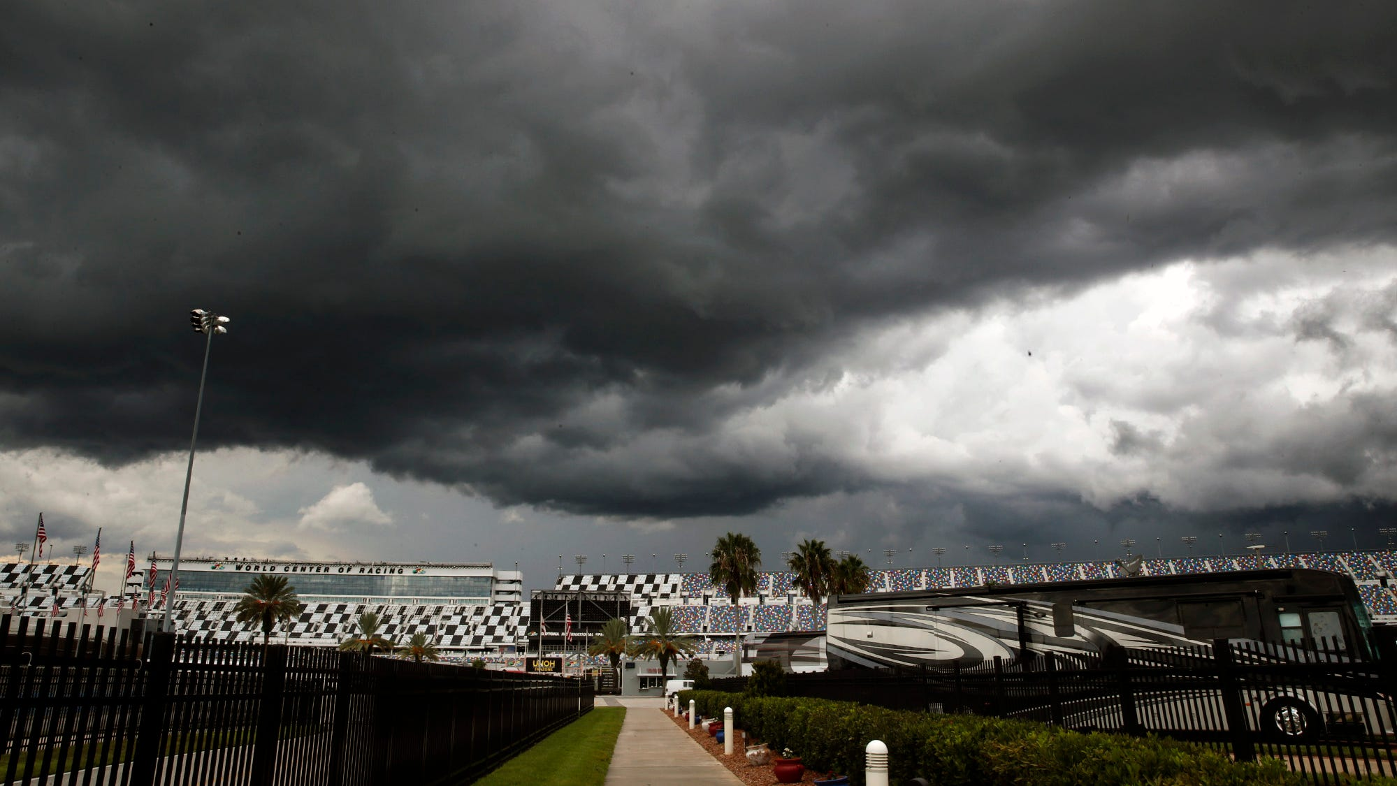 Storm clouds gather over Daytona International Speedway delaying the start of the Xfinity UNOH 188 race at Daytona International Speedway, Saturday, August 15, 2020.
