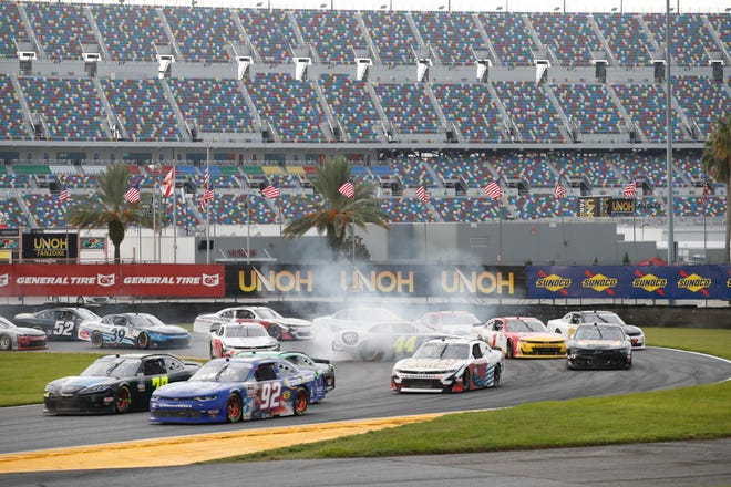 A pack of Xfinity Series drivers maneuver their cars through the infield on the Daytona Road Course as Tommy Joe Martins in the No. 44 Chevy spins out in the middle of the one of the sharp turns during Saturday's weather-delayed UNOH 188 at Daytona International Speedway. The course was put together after the Speedway was given the weekend of races that normally would have been at Watkins Glen.