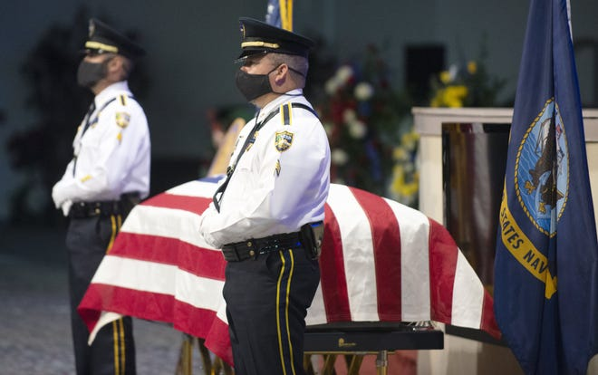 "Jacksonville Sheriff's Office Honor Guard members flanked the casket of Lt. Christopher ""Chris"" Michael Cunningham during his funeral Saturday at Paxon Revival Center Church in Jacksonville. Cunningham passed away Aug. 5 of a COVID-19 related illness he contracted in the line of duty."