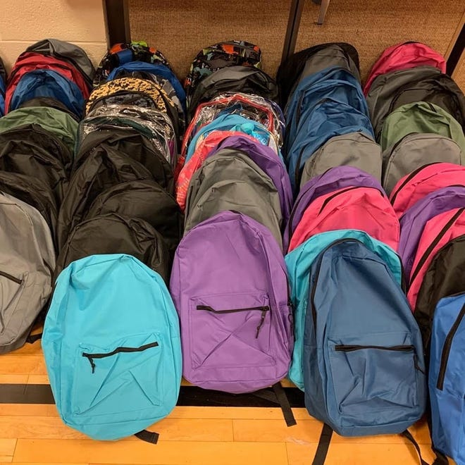 These backpacks were among those collected by the Arlington congregation of The Church of Jesus Christ of Latter-day Saints to benefit children needing school supplies. [Provided]