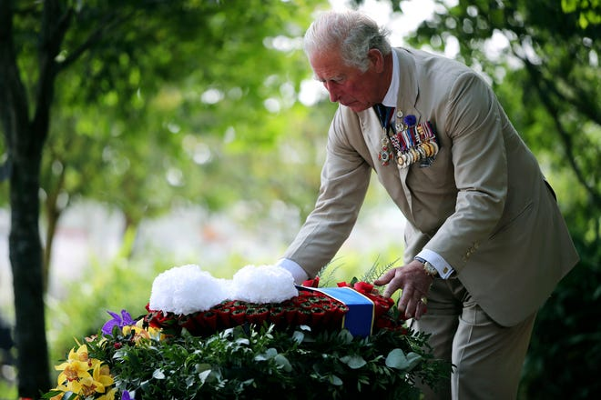 Britain's Prince Charles lays a wreath Saturday during the national service of remembrance marking the 75th anniversary of V-J Day at the National Memorial Arboretum in Alrewas, England.