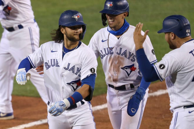 Toronto Blue Jays Bo Bichette celebrates his three-run homer with teammates against Tampa Bay Rays pitcher Aaron Loup during the sixth inning Friday, in Buffalo, N.Y. [JEFFREY T. BARNES/THE ASSOCIATED]