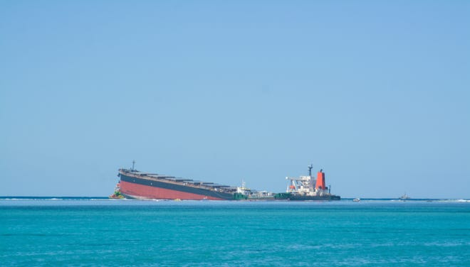 The MV Wakashio, a bulk carrier ship that recently ran aground off the southeast coast of Mauritius, can be seen from the coast or Mauritius, on Wednesday.