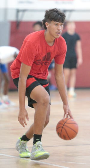 Tre Carroll of Charlotte HIgh goes through drills at the SWFL Hoops Inc. X JM Slam on Friday at Community Christian School in Port Charlotte.