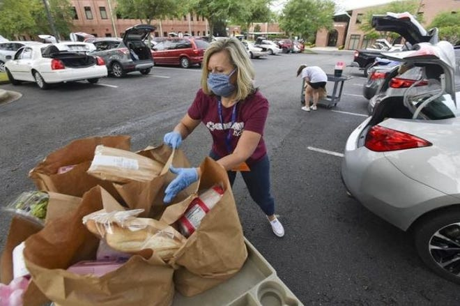 A food distribution event held earlier this year in Crestview.
