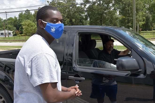 Members of the Fayetteville Branch of the NAACP held a drive-thru face mask distribution and voter registration at Christ Cathedral on Saturday.