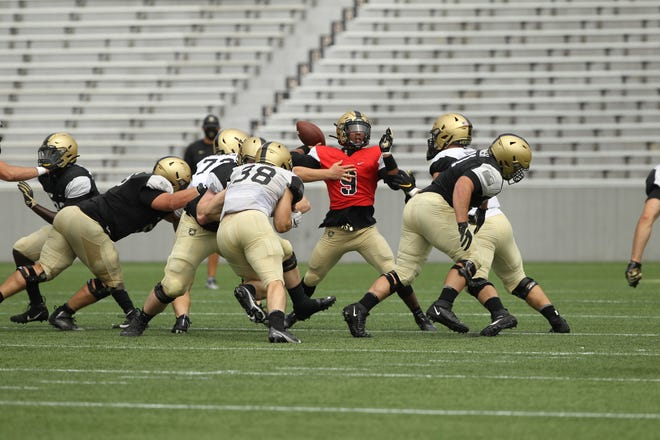 Army backup quarterback Maurice Bellan (9) prepares to throw during a recent scrimmage at Michie Stadium.