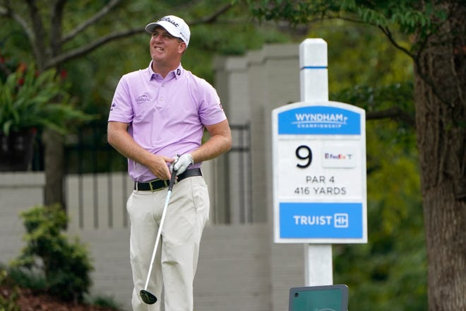 Tom Hoge tracks his drive on the ninth hole during Friday's second round at the Wyndham Championship.