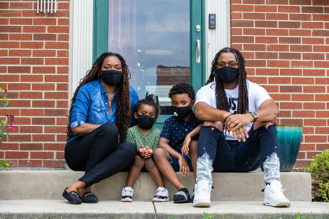 Tina and Nate Johnson of Colerain with their sons Arrison, 3, and Asten, 6. The sons were denied enrollment at Zion Temple Christian Academy because of their hairstyles. Asten was a student at the private school last year. Photo shot  Friday August 14, 2020.