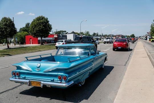 """Classic and modern vehicles cruise on Woodward Avenue for the """"unofficial"""" Dream Cruise in Royal Oak on August 15, 2020."""