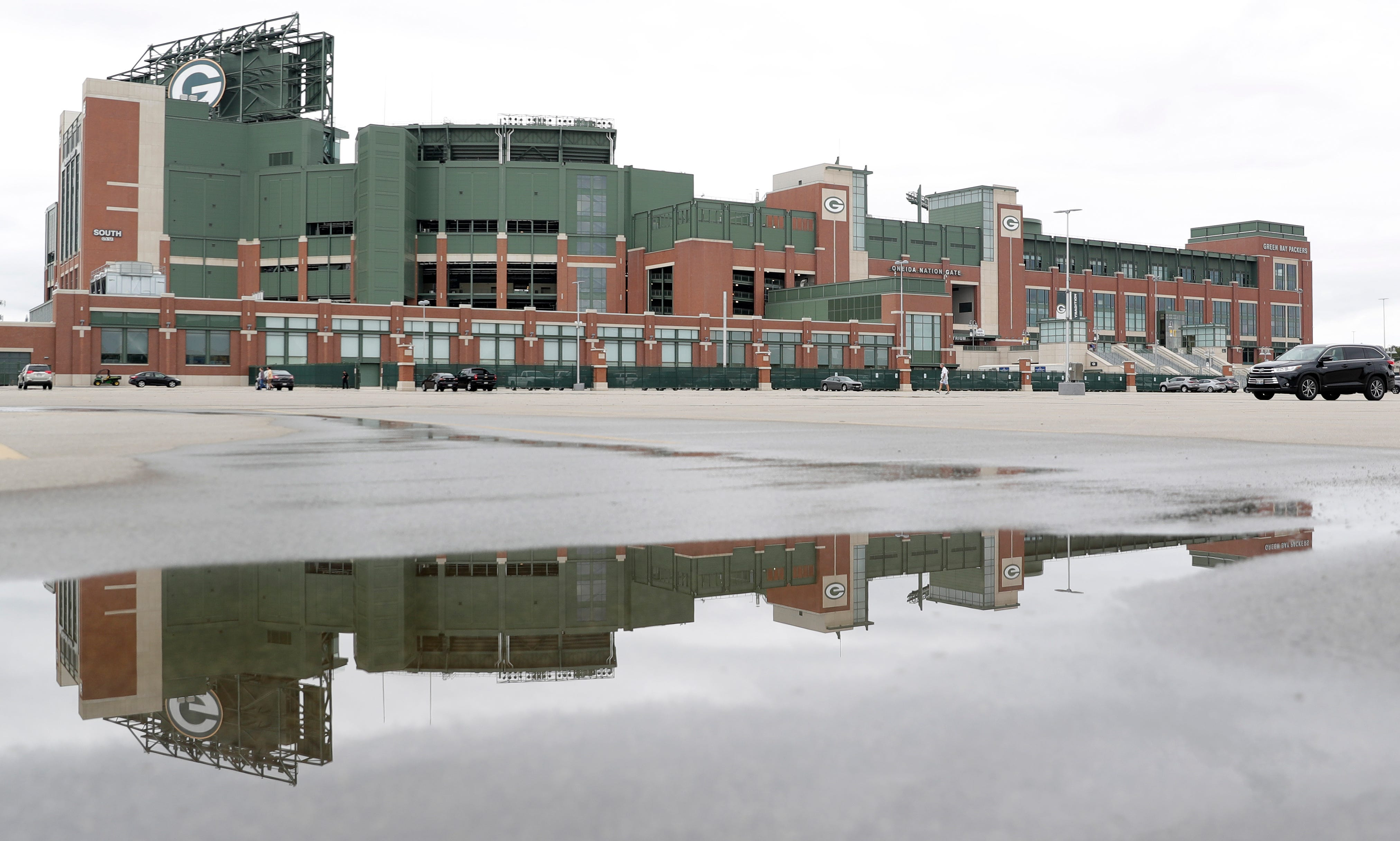 The parking lot at Lambeau Field sits mostly empty on Aug. 15, 2020, in Green Bay, Wis. The Green Bay Packers began their first practice of training camp at Ray Nitschke Field, but with no public viewing due to the coronavirus pandemic, only a few fans visited the area.