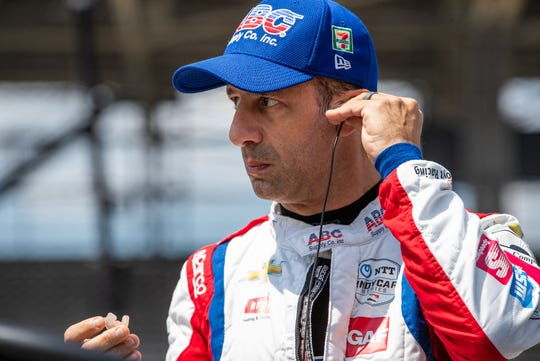 A.J. Foyt Enterprises driver Tony Kanaan (14) prepares to put on his helmet during qualifying for the 104th Indianapolis 500 at Indianapolis Motor Speedway on Saturday, Aug. 15, 2020.