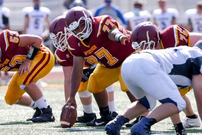 McCutcheon's Cesar Gaeta (77) calls out a motion before snapping the ball during a scrimmage, Saturday, Aug. 15, 2020 in Lafayette.
