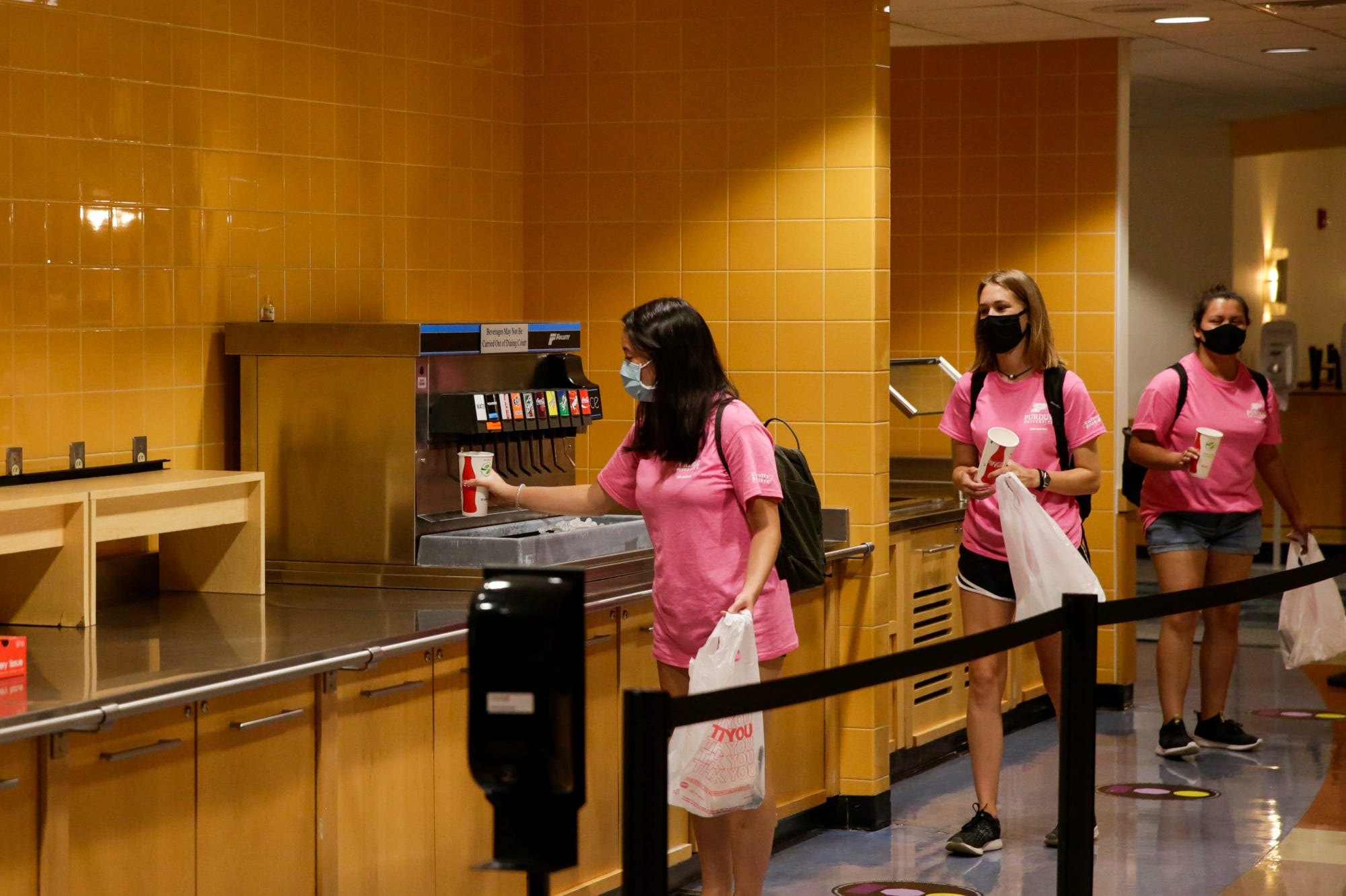 Students queue inside Earhart Dining Hall for lunch Aug. 13 at Purdue University in West Lafayette.