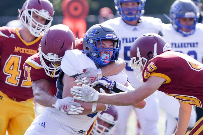 Frankfort's Riley Goodnight (13) is tackled by McCutcheon's Zaiden Zurfas (17) and McCutcheon's Jaden Shackelford (40) during a scrimmage, Saturday, Aug. 15, 2020 in Lafayette.