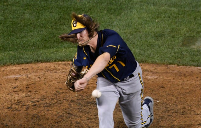 Brewers relief pitcher Josh Hader picked up a four-out save Friday night at Wrigley Field.