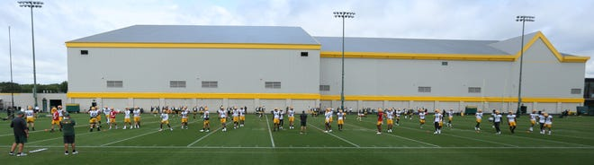 Green Bay Packers take to the field Saturday, Aug. 15, 2020, during the team's first practice at training camp in Green Bay, Wis.