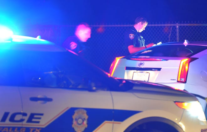 Wichita Falls police work the scene of an alleged pursuit Friday night.