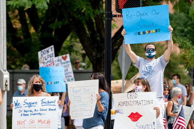 Demonstrators gathered along State and Main streets in Doylestown Borough on Saturday, August 15, 2020,  demanding in-person instruction just days after Central Bucks School District announced it would be implementing a 100% virtual format for the start of the school year due to staffing shortages amid the pandemic.