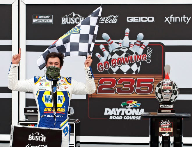Chase Elliott celebrates his historic NASCAR victory on the Daytona Road Course at Daytona International Speedway.
