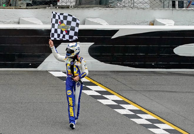 Chase Elliott celebrates Sunday evening after winning the Go Bowling 235 at Daytona International Speedway. [News-Journal/Nigel Cook]