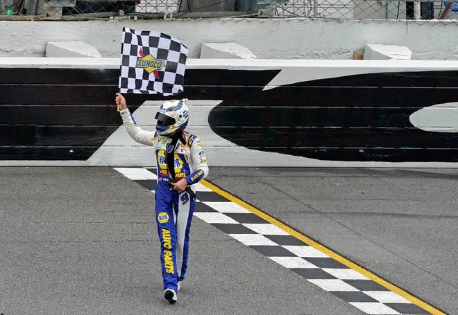 Chase Elliott celebrates Sunday evening after winning the Go Bowling 235 at Daytona International Speedway. [News-Journal/Nigel Cook]