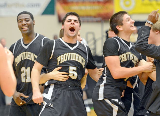 From left; Providence's David Sharpe (21), Luke Ridley (5) and Grayson Allen (1) celebrate their victory over Coral Springs Christian in the 2013 FHSAA Class 3A state boys basketball final. [Scott Wheeler/The Ledger]