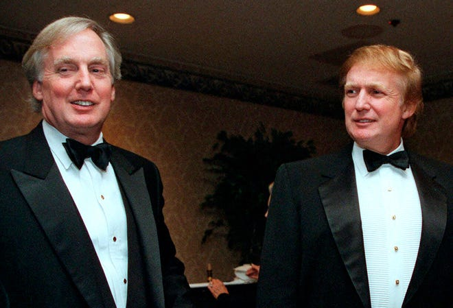 In this Nov. 3, 1999, file photo, Robert Trump, left, joins then real estate developer and presidential hopeful Donald Trump at an event in New York. President Donald Trump's younger brother, Robert Trump, a businessman known for an even keel that seemed almost incompatible with the family name, died Saturday night, Aug. 15, 2020, after being hospitalized in New York, the president said in a statement. He was 71. The president visited his brother at a New York City hospital Friday after White House officials said Robert Trump had become seriously ill. (AP Photo/Diane Bonadreff, File)