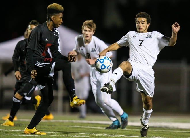 Ponte Vedra's Munir Adamo (7) and Immokalee's Roberto Gabeaud (3) challenge for the ball during the 2016 FHSAA boys soccer Class 3A State Championship. [Gary Lloyd McCullough/For the Florida Times-Union]