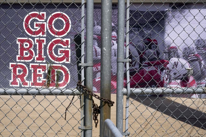 Gates leading into Memorial Stadium are padlocked Wednesday in Lincoln, Neb. The Big Ten won't play football this fall because of concerns about COVID-19.