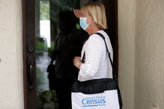 A census taker knocks on the door of a residence last week in Winter Park. A half-million census takers head out en mass this week to knock on the doors of households that haven't yet responded to the 2020 census.