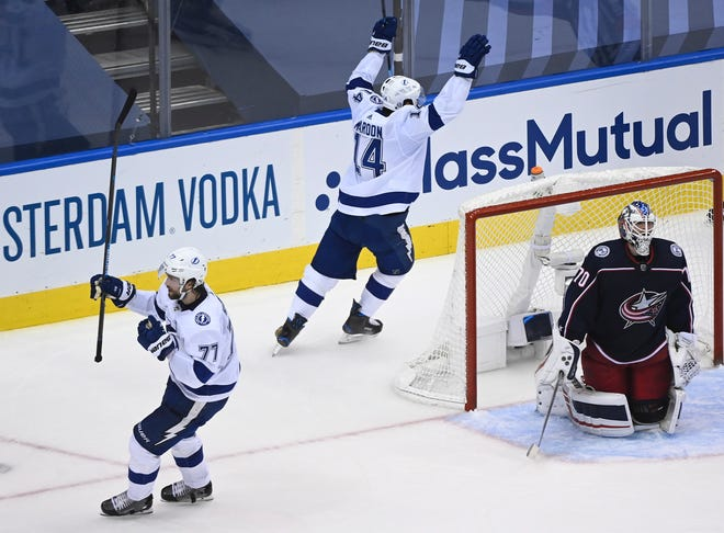 Tampa Bay Lightning defenseman Victor Hedman (77) celebrates his goal as Columbus Blue Jackets goaltender Joonas Korpisalo (70) looks on during the second period of an NHL Eastern Conference Stanley Cup playoff game in Toronto on Saturday.