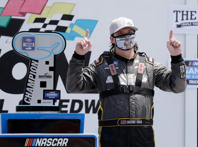 Sheldon Creed celebrates in Victory Lane after winning the NASCAR Truck Series auto race at Daytona International Speedway on Sunday in Daytona Beach.