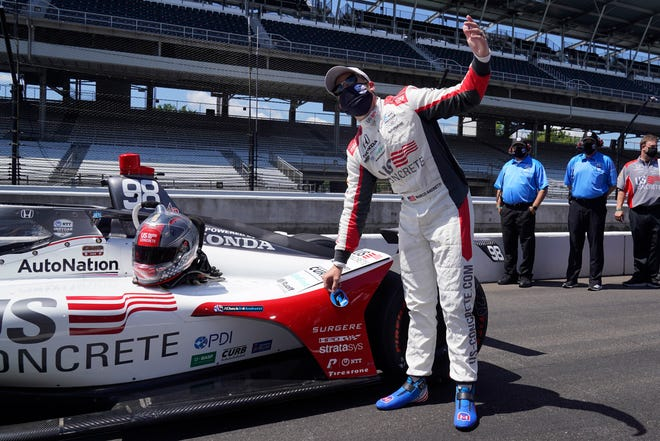 Marco Andretti reacts after winning the pole for the Indianapolis 500 auto race at Indianapolis Motor Speedway on Sunday.