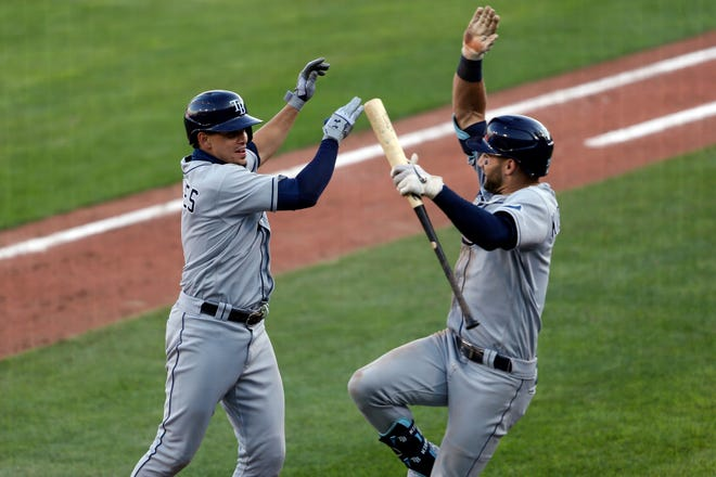 Tampa Bay Rays' Willy Adames, left, celebrates his two-run home run with teammate Kevin Kiermaier during extra innings of a game against the Toronto Blue Jays on Sunday in Buffalo, N.Y.