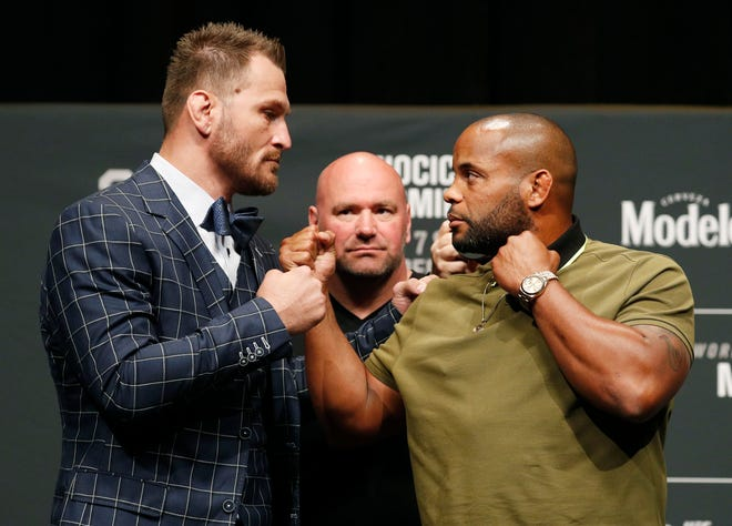 Stipe Miocic, left, and Daniel Cormier pose during a July 2018 news conference for UFC 226 in Las Vegas. Miocic defeated Cormier by unanimous decision in a five-round bout Saturday night to win the rubber match in a fantastic trilogy between the fighters and retain his heavyweight championship at UFC 252.