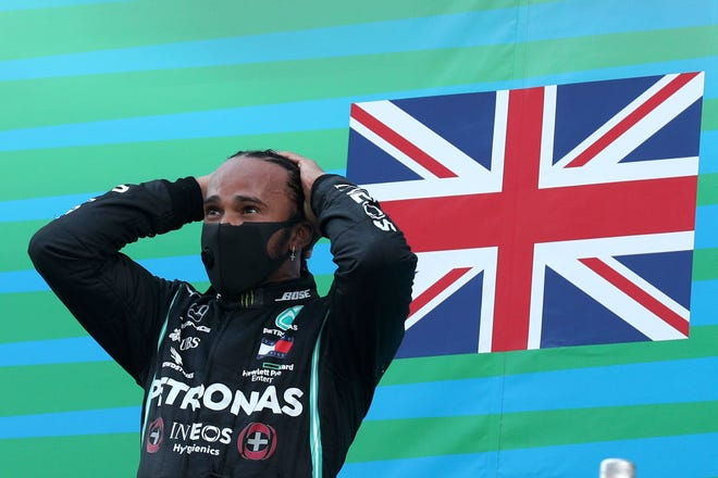 Mercedes driver Lewis Hamilton of Britain celebrates on the podium after the Formula One Grand Prix at the Barcelona Catalunya racetrack in Montmelo, Spain, on Sunday.