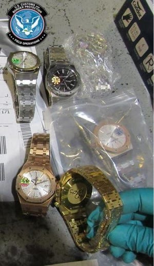 U.S. Customs and Border Protection officers seized 54 counterfeit watches in Cincinnati.