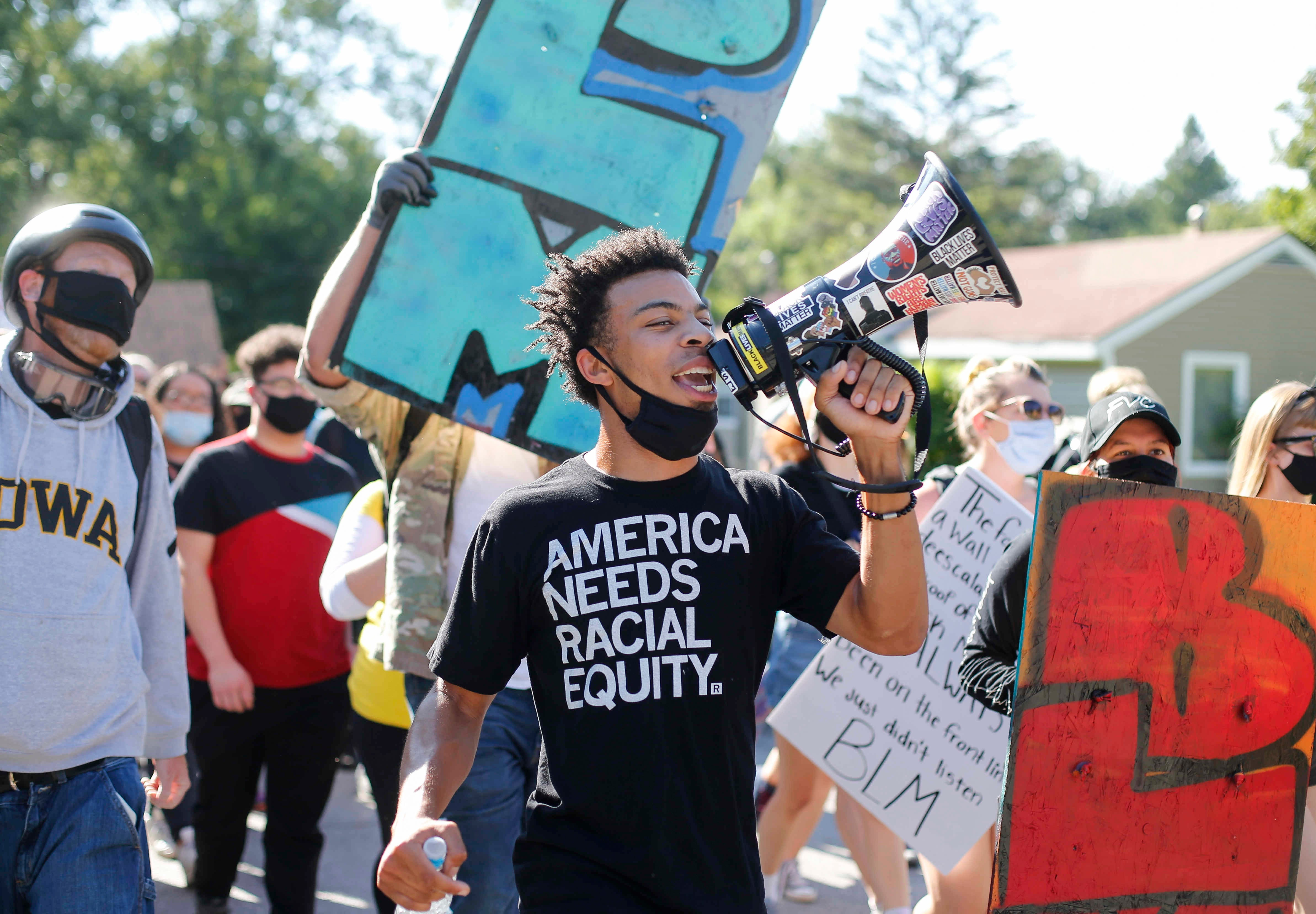 Matthew Bruce leads protesters with BLM Des Moines in a march in on Saturday, Aug. 15, 2020, to a home owned by Des Moines City Councilman Joe Gatto to vocalize a list of demands.