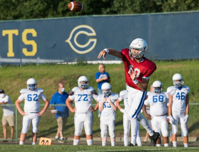 Memorial's Colton Pence (10) throws a pass as the Tigers scrimmage the Castle Knights at John Lidy Field in Newburgh, Ind., Saturday evening, Aug. 15, 2020.