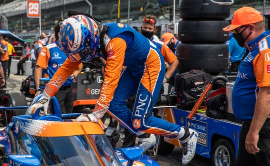 Chip Ganassi Racing driver Scott Dixon (9) loads into his car during the Fast Nine Shootout for the 104th Indianapolis 500 at Indianapolis Motor Speedway on Sunday, Aug. 16, 2020.