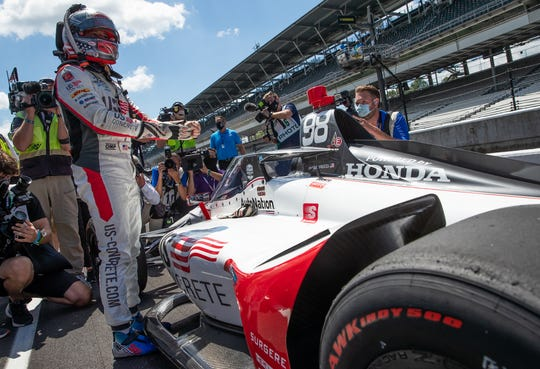 Andretti Herta Autosport with Marco & Curb-Agajanian driver Marco Andretti (98) gets out of his car after securing the pole position during the Fast Nine Shootout qualifying for the 104th Indianapolis 500 at Indianapolis Motor Speedway on Sunday, Aug. 16, 2020.