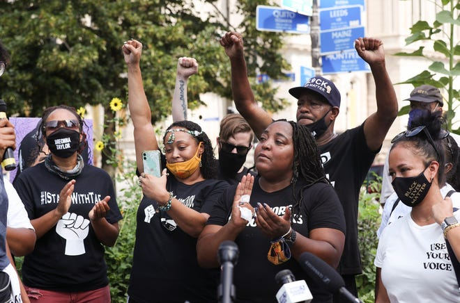 Supporters reacted to speakers during a press conference held by the Kentucky Alliance Against Racist and Political Repression at Jefferson Square Park on Aug. 16, 2020 to announce a bill that would extend Breonna's Law statewide by banning no-knock warrants.