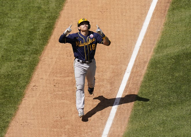 Keston Hiura points too the sky as he heads home after hitting a three-run homer for the Brewers in the third inning against the Cubs.