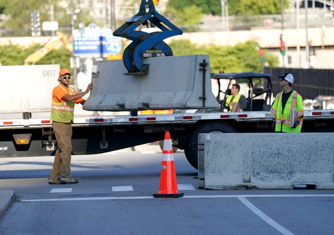 Crews put up barricades along North Phillips Avenue blocking traffic on East Kilbourn Avenue as final preparations were taking place Sunday for the Democratic National Convention at the Wisconsin Center.