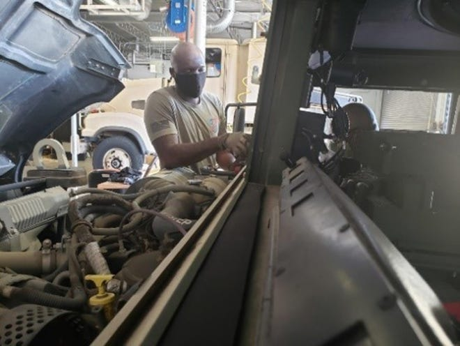 Spc. Tarriant Martin, wheeled vehicle mechanic from the 803rd Quartermaster Company, removes a Humvee windshield to prep it for replacement in Opelika, Ala., Aug. 3, 2020.