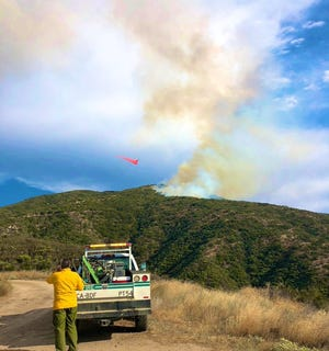 A plane dropped fire retardant on a fire near Mountain Center on Saturday, Aug. 15, 2020.