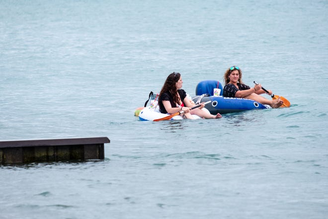 Floaters enter Lake Huron ahead of this year's Float Down Sunday, Aug. 16, 2020, at Lighthouse Beach in Port Huron.