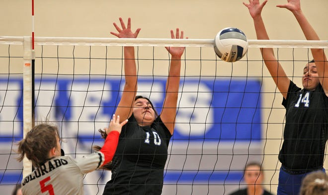Emma Guevara, center, and Brandy Coward, right, try to block a shot for Lake View during a game against Colorado City on Saturday, Aug. 15, 2020.